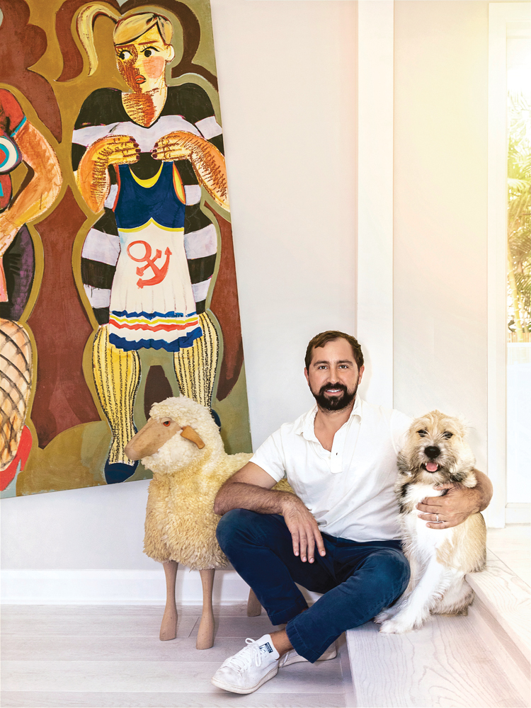A Palm Beacher by way of New York, Chris Vila, pictured here with Pickles, is using his development skills to better West Palm Beach.