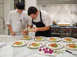 Executive Chef Drew Garms and his team prepared a memorable feast that included poached Maine lobster tails with mango, smoked avocado, pickled endive, and toasted macadamia nuts.