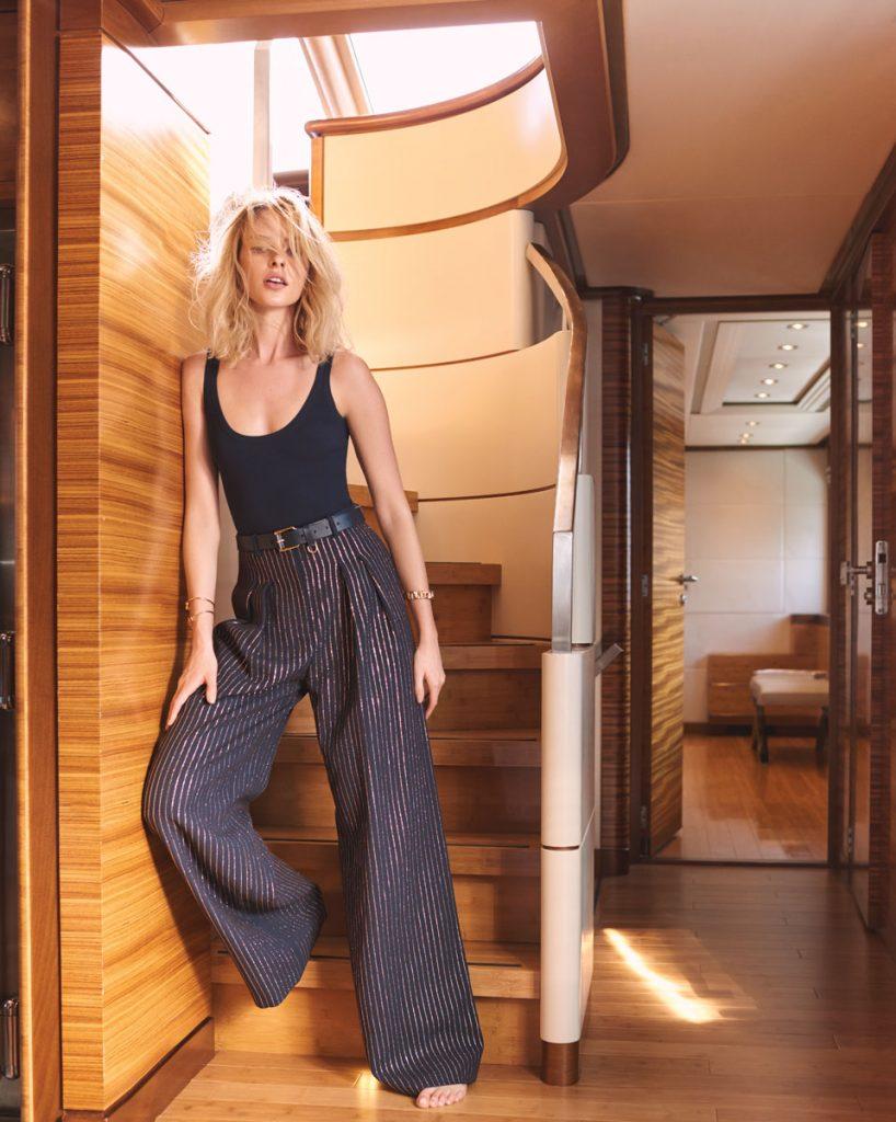 Michael Kors Collection bodysuit, trousers, belt; Tiffany & Co. bracelets.