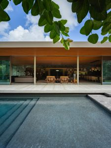 Living and dining rooms seen from the pool.
