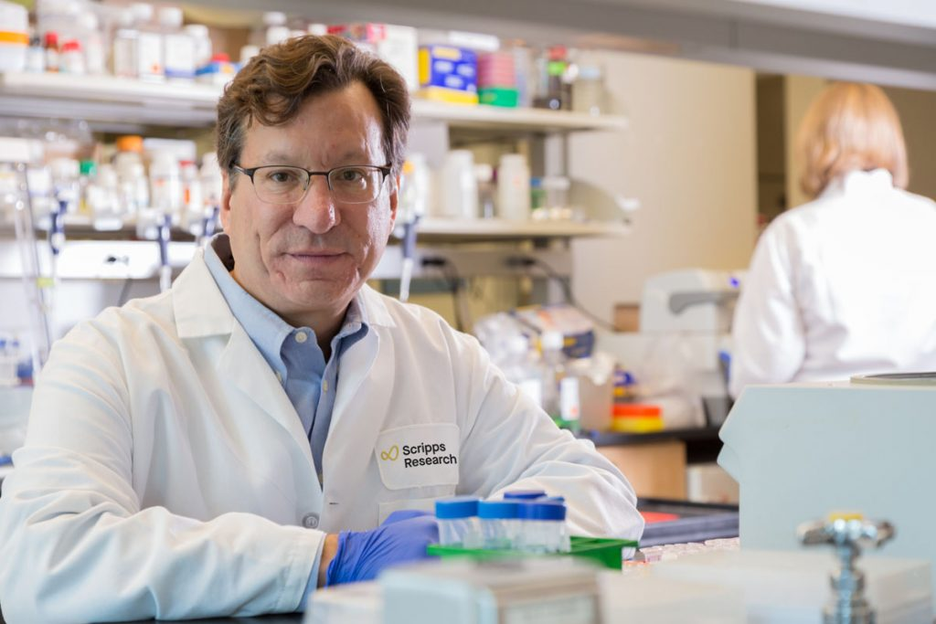 Dr. Michael Farzan, professor and co-chair of the Department of Immunology & Microbiology, in the lab. Image courtesy of Scripps Research Institute.