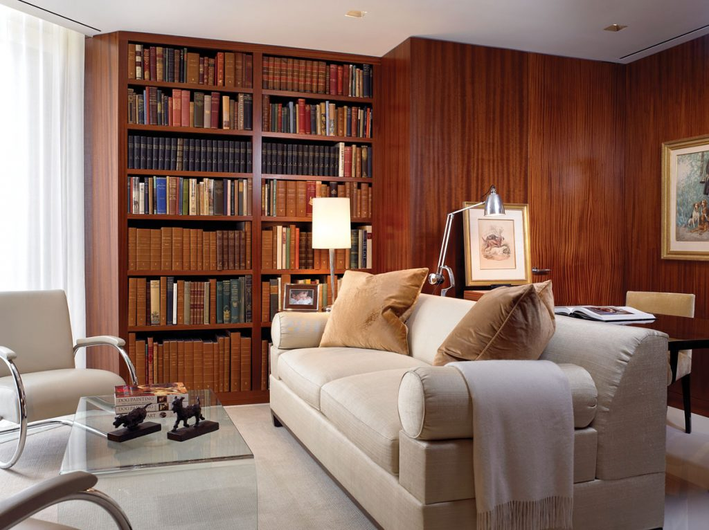The couple embraced the home's once off-putting angles in Secord's office, which houses a portion of his large book collection on the topic of dog paintings.
