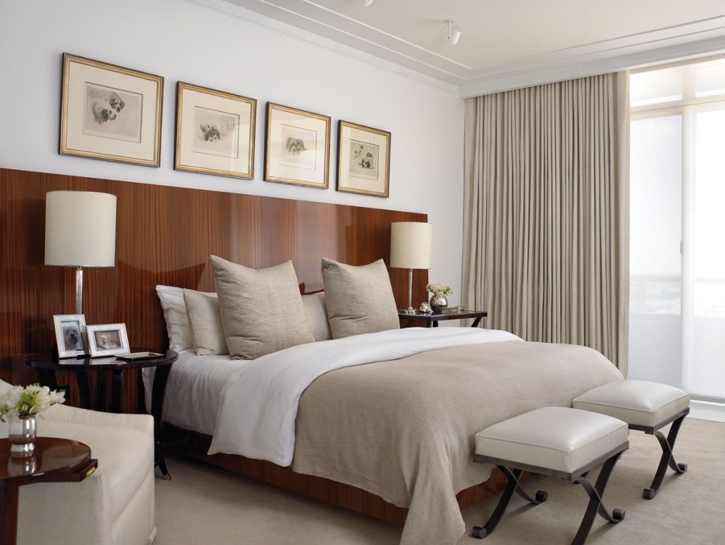 The master bedroom includes a mahogany headboard and a range of linens in a crisp taupe hue