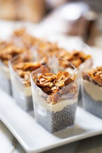 The meal began with passed hors d'oeuvres, including chia seed parfaits with granola.
