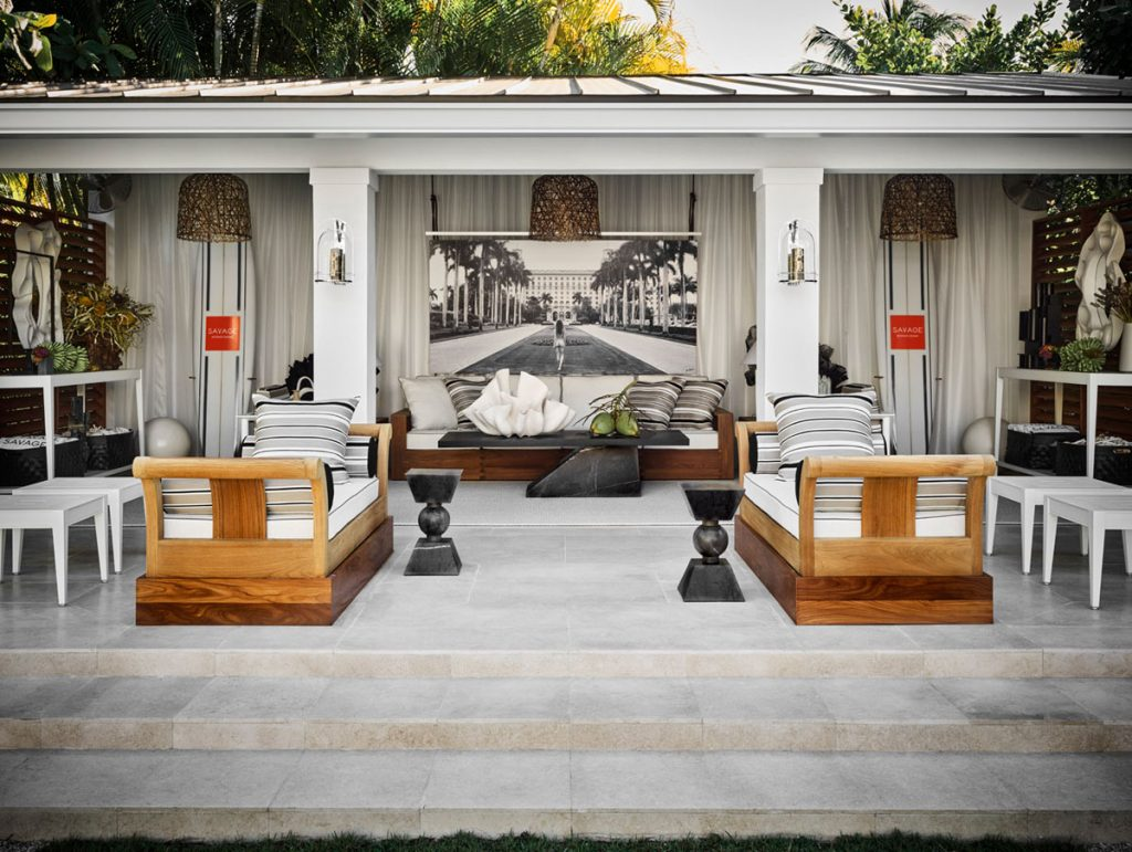 For the 2020 Kips Bay Decorator Show House Palm Beach, Savage created a serene poolside getaway featuring a pair of teak daybeds from Sutherland Furniture. The large format photograph of a female nude at The Breakers is by Nathan Coe. <br/> Photo by Douglas Friedman