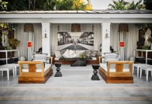 For the 2020 Kips Bay Decorator Show House Palm Beach, Savage created a serene poolside getaway featuring a pair of teak daybeds from Sutherland Furniture. The large format photograph of a female nude at The Breakers is by Nathan Coe. Photo by Douglas Friedman