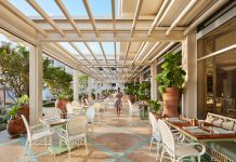 Outdoor terrace dining at Florie's. Photo courtesy of Four Seasons Resort