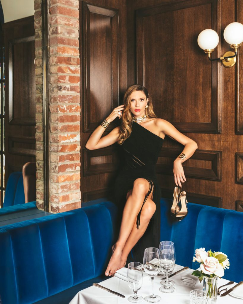 PBI, Bettina Anderson wearing Hervé Léger and Gianvito Rossi, at Café L'Europe, photo by Nick MEle