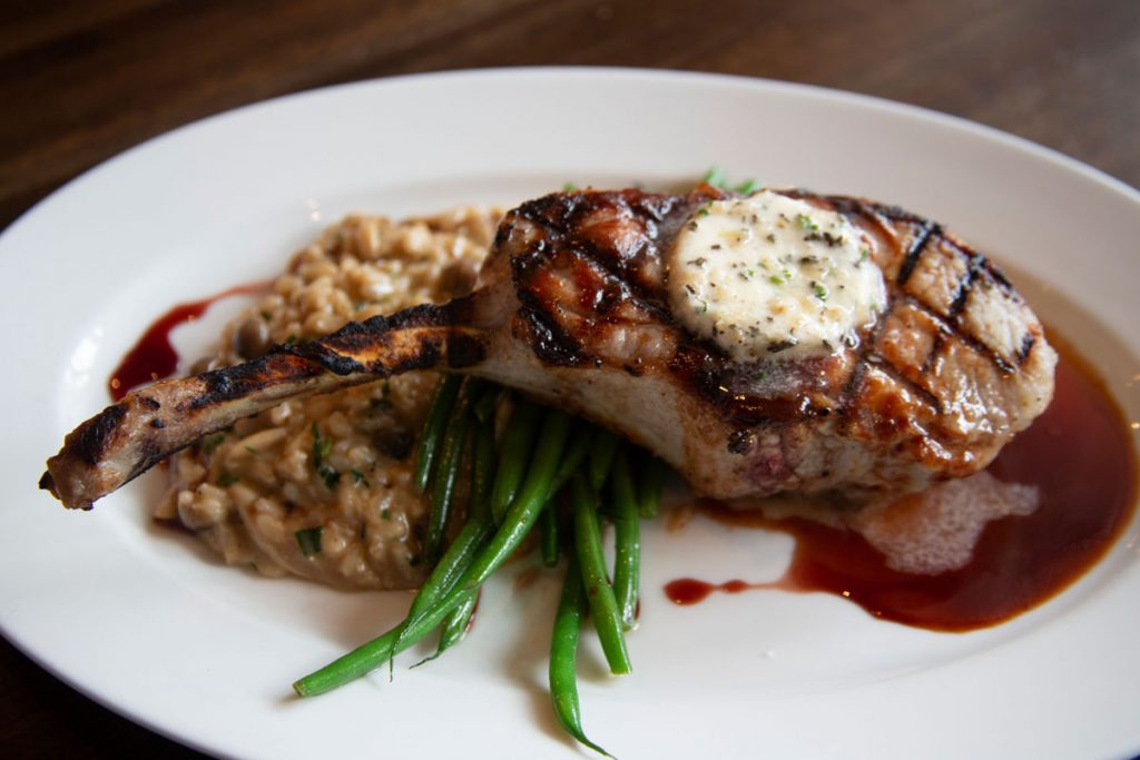 Chef Rolando Anoceto will serve a 16 oz. Niman Ranch pork chop on Father's Day. Photo by Think.Shop