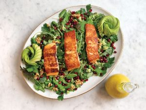 Some foods pack a powerful punch against inflammation, like this lightly seasoned crispy salmon and antioxidant-rich salad with ginger-turmeric dressing.