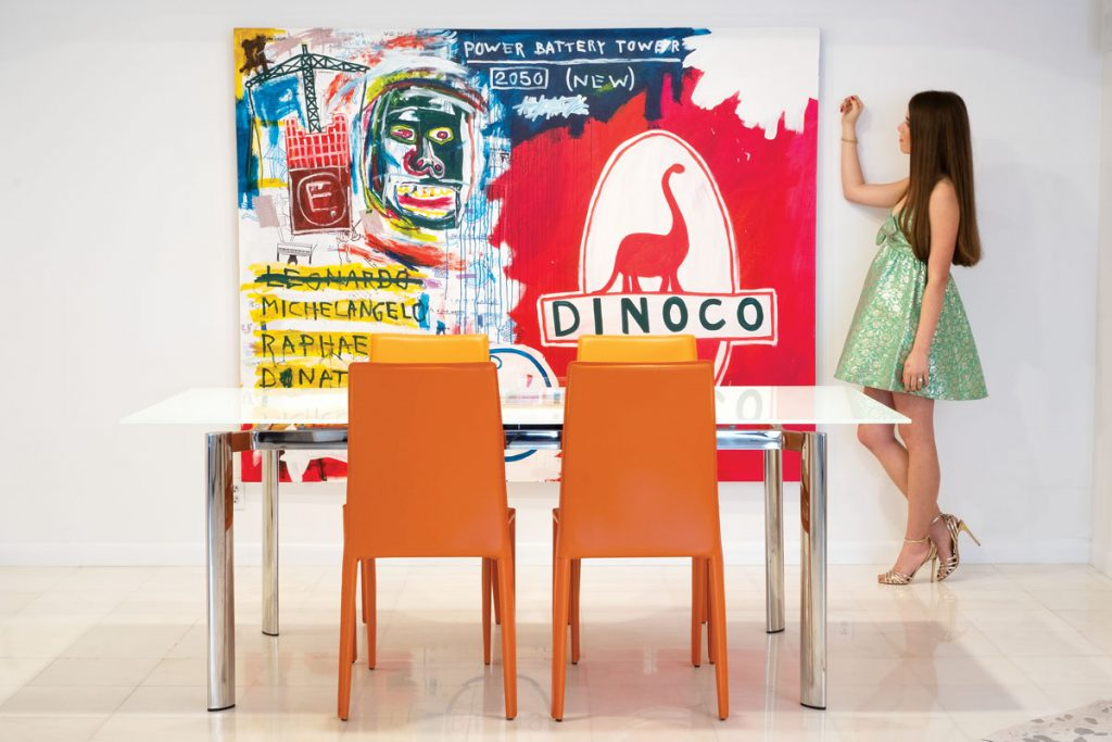 Nolan admires Dinoco 2050 by Diego Medina, a self-taught artist and filmmaker based in Mexico, photo by Jerry Rabinowitz