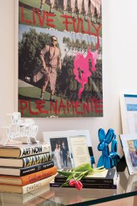 Plenitud by Diego Medina resides above artistic keepsakes and books, as well as a framed image of Michael and Nolan on their wedding day and a copy of their wedding announcement