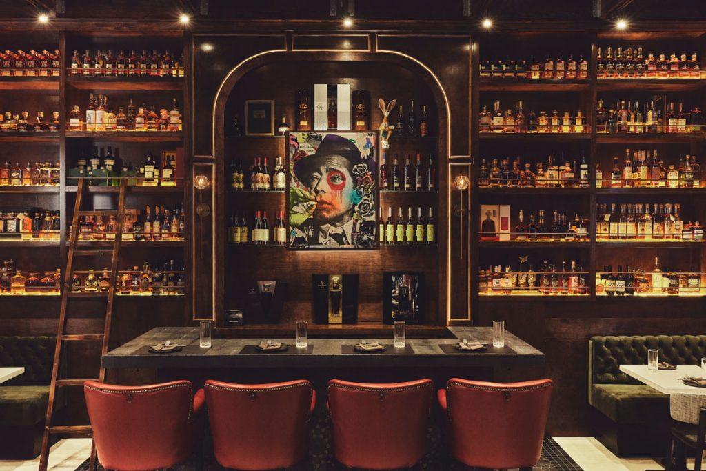 Wall of whiskeys at Warren. Photo by Felipe Cuevas.