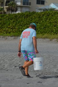 Beach cleanup participant