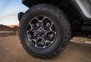 The 2021 Jeep® Wrangler Rubicon 4xe rides on 17-inch aluminum wheels fitted with all-terrain off-road tires.