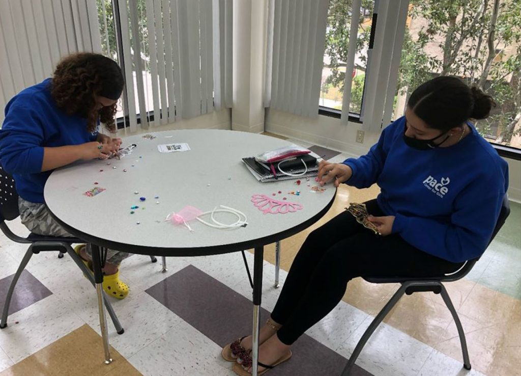 """Girls Circle: Honoring Diversity participants completing a creative expression project based on the quote, """"real queens fix each other's crowns."""" Pace Center for Girls"""