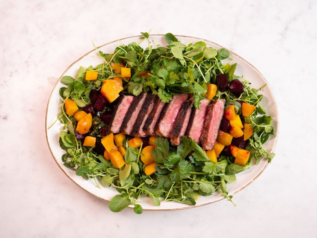 Grilled Steak with Roasted Beets, Sautéed Beet Greens, and Fresh Watercress, photo by Kent Anderson