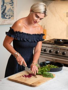 Chopping beet greens, which aid in the body's natural detox process.