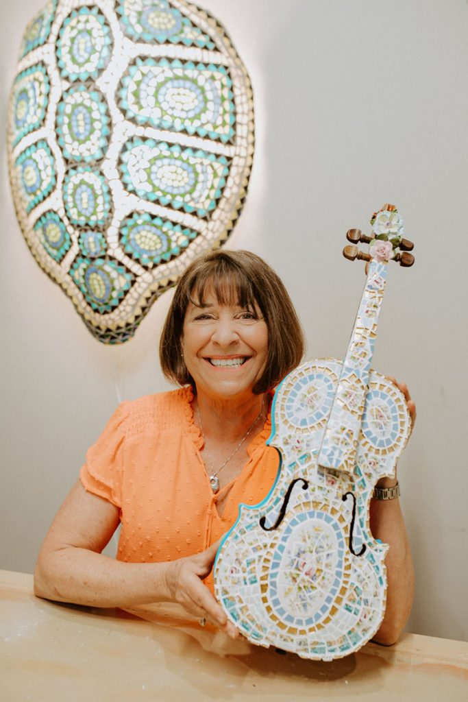 Faith Schwack with one of her transformed violins.
