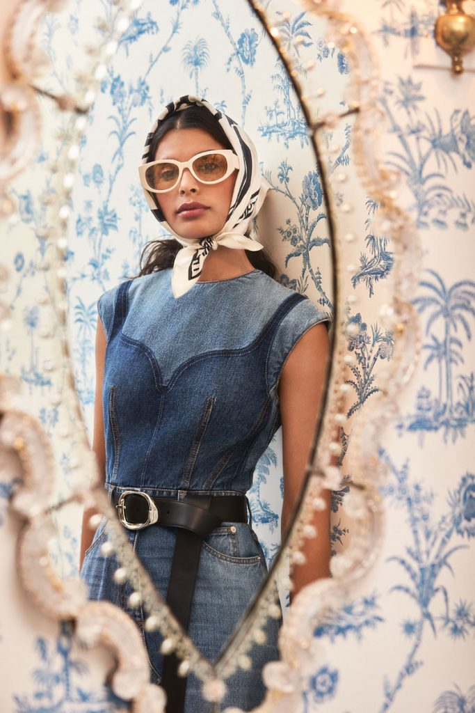 Lilly Reilly wearing Alexander McQueen sunglasses, denim dress, leather belt, photo by Gabor Jurina