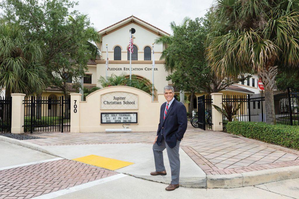 Seth Cohen in front of Jupiter Christian School
